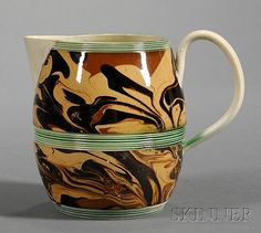 Small Mochaware Jug, Britain, c. 1780, barrel-form jug with green reeded bands flanking the black, rust, and pumpkin slip marbled fi...