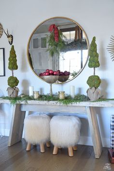 christmas-home-tour-round-gold-mirror-christmas-styling-decor-white-tulip-table-natural-garland-2