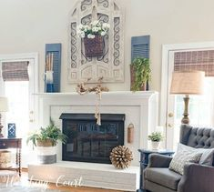 Farmhouse style painted brick fireplace decorated with simple and organic elements for the summer. Farmhouse style painted brick fireplace decorated with simple and organic elements for the summer. Brick Fireplace Decor, Red Brick Fireplaces, Simple Fireplace, Brick Fireplace Makeover, Living Room With Fireplace, Fireplace Design, Fireplace Mantels, Farmhouse Fireplace, Fireplace Decorations