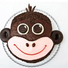 How to make a monkey birthday cake with chocolate covered-doughnuts. Easy, step-by-step recipe, diagrams and pictures