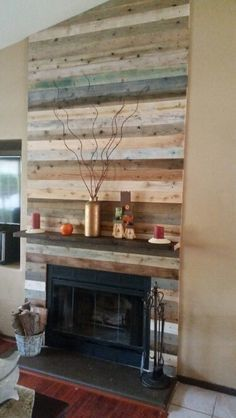 Using reclaimed wood and pallets with a modern electric fireplace ...