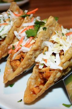 "Chicken Wonton Tacos | ""Light and tasty, these make a great appetizer or a quick and easy main dish! Kids love them! I loved the ones at Applebee's®️️ and decided to attempt a home version. I was extremely pleased with the healthier version!"" #allrecipes #copycat #copycatrecipes Chicken Wonton Tacos, Chicken Wontons, Soy Sauce Stir Fry, Coleslaw Dressing, Ground Chicken, Chinese Food, Chinese Meals, Homemade Coleslaw, Teriyaki Sauce"