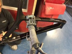 We repaired the top tube and down tube of this MTB Carbon frame and we painted the frame two tone colour flat black and metallic black ready for decal application, another in  process project at CarbonWork for October 2016