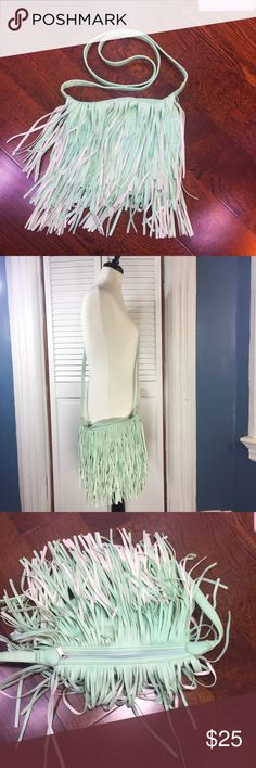 "Layered Fringe Cross-body/Shoulder Bag Mint color Layered fringe. Cross-body/Shoulder Bag. Beautiful mint color. Zip-Top closure. Interior pockets. Approximate measurements (measured flat): width: 10"", length: 9"", Drop: 32.5. NWOT. Bags Crossbody Bags"