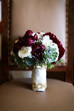 succulents, burgundy dahlias, burgundy peony, gardenias and white flowers bridal bouquet with trim