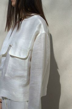 Contemporary Fashion - white shirt with large flap pocket detail // Nanushka