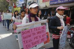 Participants hold placards as they take part in a rally to mark the 102nd International Women's Day in Kathmandu, Nepal, March 8, 2012. REUTERS/Rajendra Chitrakar