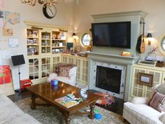 Family Room, reconfigured preexisting built-ins with mirrored cabinet doors, painted in Creme by Pratt and Lambert