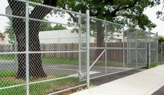 Chain link fence is durable, very cost effective, and suitable for residential fence construction as well as security fencing for commercial buildings, parking lots, marinas, sports fields & stadiums, and high security areas like airports, nuclear power plants, and city & county governments. Galvanized chain link fencing is silver but also comes in vinyl or powder coated colors such as black, dark brown, dark green and white.