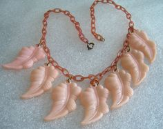 Vintage art deco old delicate pink celluloid leaves necklace by ThePlasticFever on Etsy https://www.etsy.com/listing/151287465/vintage-art-deco-old-delicate-pink