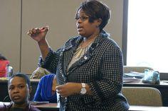 Darisha Miller, Director of Media Relations, Ross Associates, Inc. poses a question to panelists.