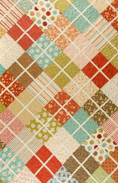 Easy scrap quilt with charm squares or layer cakes--or dig into your stash. Crossing Paths pattern by Black Mountain Needleworks.