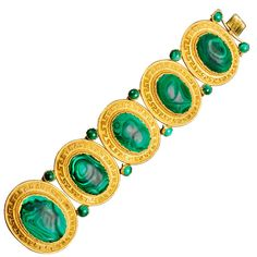 Gold and malachite bracelet, Russian (St. Petersburg), c. 1860. Designed as a line of five oval malachite links, each within a gold Greek key border, the bracelet is enhanced with pairs of round malachite accents. The last link is slightly larger than the rest to form the centerpiece of the bracelet when worn.