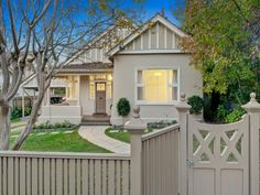 Rendered brick victorian house exterior with picket fence & landscaped garden - House Facade photo 1309317