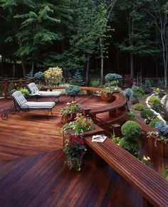 Outdoor deck with built-in planters and bench seating.