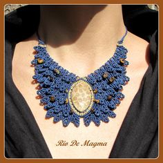 Coral Fossil Necklace. Macrame navy blue necklace with tigers