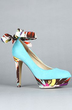 Suedette closed toe pump with floral ankle tie, heel, and platform. 5inch heel with 1.5inch platform