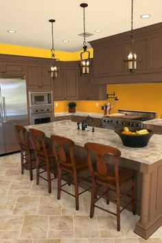 Sunny walls in the kitchen can brighten up any meal. (Shown on the kitchen walls is Pratt & Lambert Patent Yellow 12-10.)