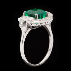 Colombian Emerald Art Deco Ring | From a unique collection of vintage cocktail rings at http://www.1stdibs.com/jewelry/rings/cocktail-rings/
