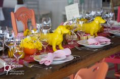 color chairs, farm table, yellow wiener dogs by Renee Landry