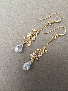 Faceted CZ Crystal & Pearls Earrings in 14k Gold Fill  Faceted CZ crystals, white Swarovski pearl cluster earrings on 14k gold fill chain. 1.5 inch drop.
