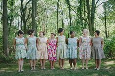 floral bridesmaids dresses- all the same dress pattern, all different colors, i think it's really cute!