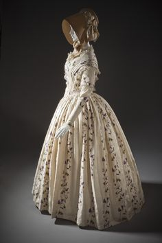 Dress: ca. 1845-1849, English, silk plain weave with warp-float patterning, printed, silk lace and silk passementerie.