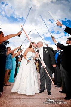 May the force be with you! Star Wars fans will love this wedding send off with light sabers!