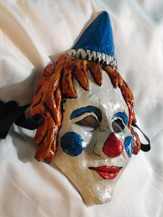 Clown paper mache mask. $40.00, via Etsy.