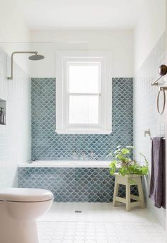 Fishscale: Handmade fish scale, or mermaid, tiles become a key feature in this bathroom with a generous window becoming the highlight. Project: Brave New Eco Diy Bathroom, Bathroom Storage, Modern Bathroom, Bathroom Ideas, Master Bathrooms, White Bathroom, Cream Bathroom, Mosaic Bathroom, Bathroom Designs