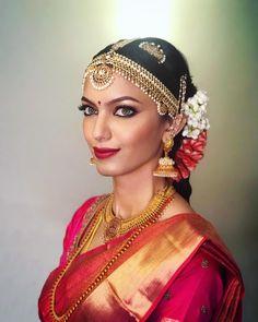 South Indian bride. Gold Indian bridal jewelry.Temple jewelry. Jhumkis. Red silk kanchipuram sari. Braid with fresh jasmine flowers. Tamil bride. Telugu bride. Kannada bride. Hindu bride. Malayalee bride.Kerala bride.South Indian wedding. Jyothsna Chakravarthy. Pinterest: @deepa8