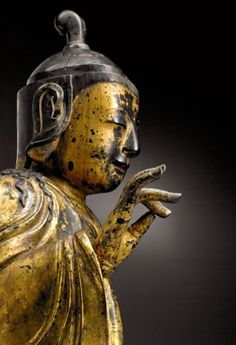 A 17th C. Korean bodhisattva where buddhist texts inserted in the head and the belly were recently discovered. Carved from a single piece of wood, except for the ears, hand and base which are attached with hand-made iron nails.