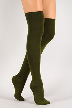 Description Solid color thigh high socks with an elastic top. Measurement One size fits most.