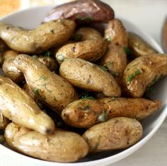 Roasted Fingerlings with Capers and Dill  - Easy roasted potatoes seasoned with fresh dill and topped with fresh capers. The perfect side dish and perfect for a picnic!