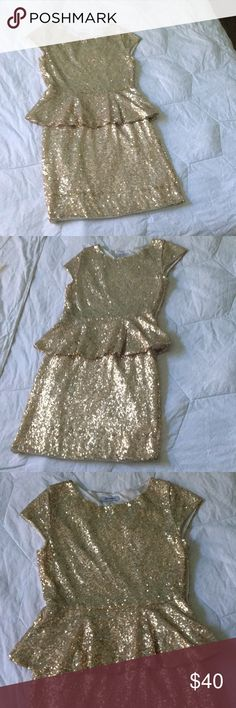 Champagne sparkly sequin dress Loved this dress for my winter formal! Got so many compliments on it. Inside is a soft material and it fits pretty comfortably. Xtaren Dresses Midi