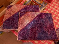 Placemats using batiks. Made 4 of them. Inserted the second color. Added backing and binding. Quilted at an angle to the bias trim.