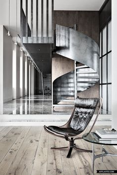 An eye catching display of Masculine interior design in a Moscow penthouse. The steel staircase is softened with it's spiral design and warm timber backdrop. a clever use of form and function. Design Despace, Deco Design, House Design, Chair Design, Design Ideas, Masculine Interior, Modern Interior, Interior And Exterior, Interior Stairs