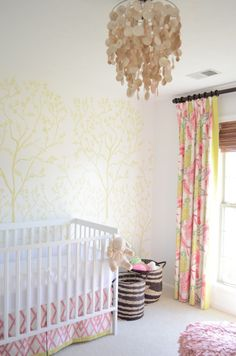 this wallpaper is subtle and beautiful.  again, an accent wall behind the crib is a great idea and an easy thing to change as the room grows with the child.  re-painting or re-papering one wall is 1/4 (or less!) the work.