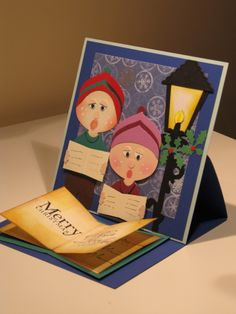 I spied the instructions to make these guys from SU's Ornament punch here- I love Andrea's cute idea for the head and the hat! The lamp light is from the tag punch that I cut to taper it to the r...