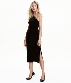 Check this out! Fitted, knee-length dress in crushed velvet. Narrow cut at top with low-cut V-neck at back, narrow shoulder straps crossed at back, and slit at one side. Lined. - Visit hm.com to see more.