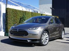 Tesla took the wraps off its third all-electric model at its Los Angeles design center. The Model X is built on the same platform as the Model S, but uses an SUV-style body. - Page 1