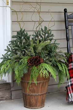 Quick and easy tutorial for making these GORGEOUS winter porch pots. Quick and easy tutorial for making these GORGEOUS winter porch pots. Made in baskets for a farmhouse style, but can be made in urns for a more formal look! Outdoor Christmas Planters, Christmas Urns, Farmhouse Christmas Decor, Rustic Christmas, Christmas Home, Christmas Crafts, Outdoor Planters, Winter Christmas, Christmas Front Porches