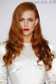 Ultra-glam side swept fiery locks | Riley Keough