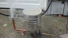 Miss Betsy's Cold Smoke Generator. Feeder on top. Venturi elements on bottom. Modify this design to eliminate the galvanized pipe (seen in the middle of the brass and copper fittings).