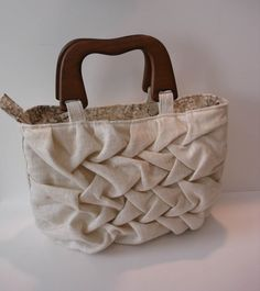 OK so some people are not into colourful.  THis is for those people. This is restrained, elegant, (not easy to make) and smart.  A great gift for a cool chick of any age for summer living out and about in the sunshine. $62.00 #elegance #cream #subtle #handbag #purse, #wood #linen #lattice #smocking #cotton #summer #spring