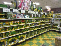 Lousy picture of John Deere farm toys inside Parrott's Implement