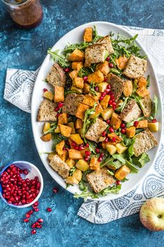 An autumn panzanella salad filled with roasted vegetables, toasted bread cubes and wonderful spiced pomegranate vinaigrette.