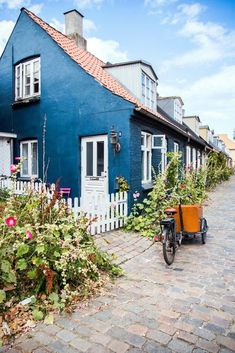 If you're visiting downtown Aarhus, you can't miss Møllestien! It's the prettiest cobblestone street in Aarhus with the most colorful historic houses Aarhus, Denmark House, Denmark Travel, Historic Homes, Day Trip, House Colors, Future House, Places To Go, Beautiful Places