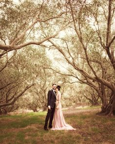 Blush wedding dress in a forest