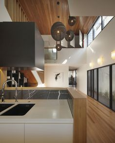 http://sandavy.com/amusing-dynamic-modern-architecture-imposing-wilden-street-house-in-australia-design-concept/knockout-wilden-house-design-ideas-white-interior-kitchen-ideas-modern-kitchen-set-pendant-lamp-glass-door-kitchen-island-stainless-steel-faucet-wooden-flooring-kitchen-design-ideas-wooden-roof-abstra/